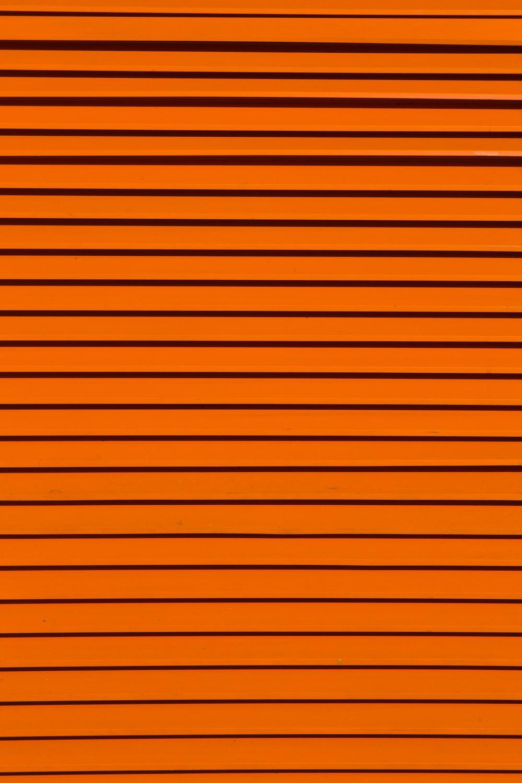 minimalist photography of orange wall