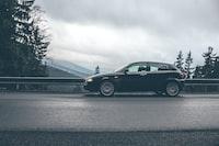 black car near road rails