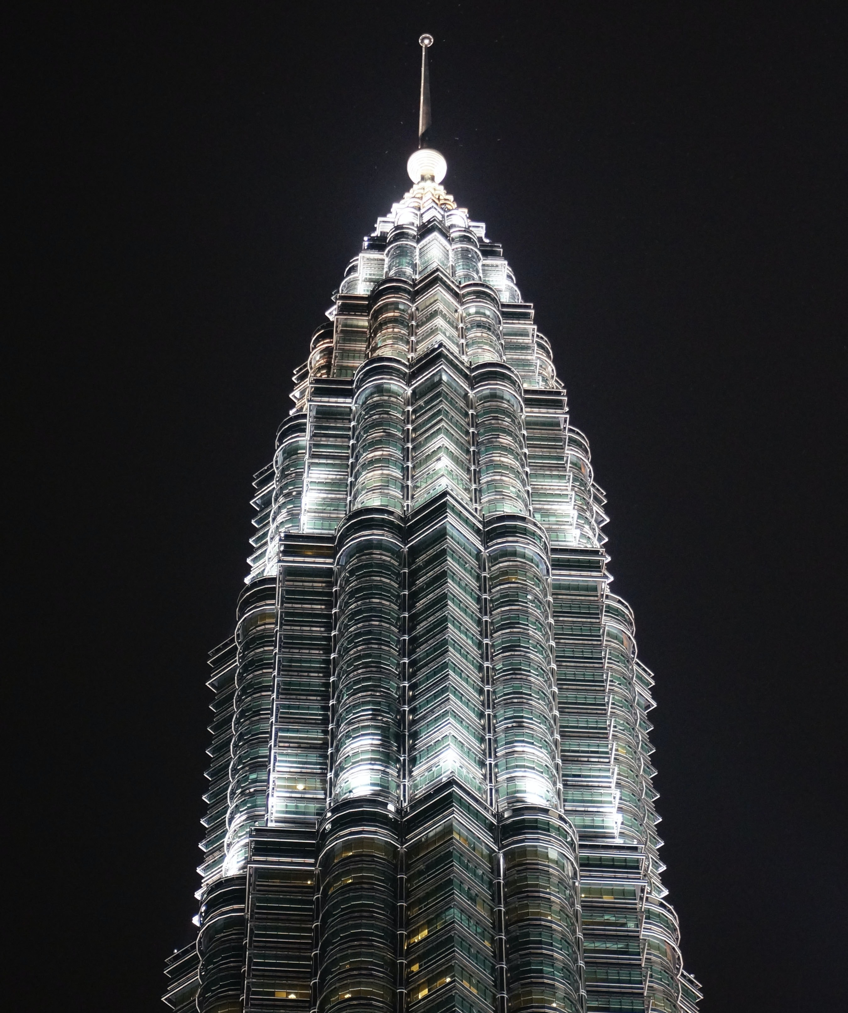 high-rise gray building at nighttime
