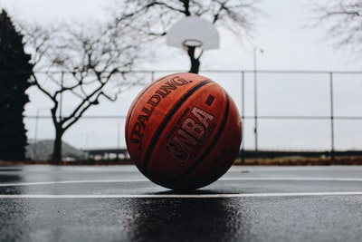 spalding basketball in court basketball teams background