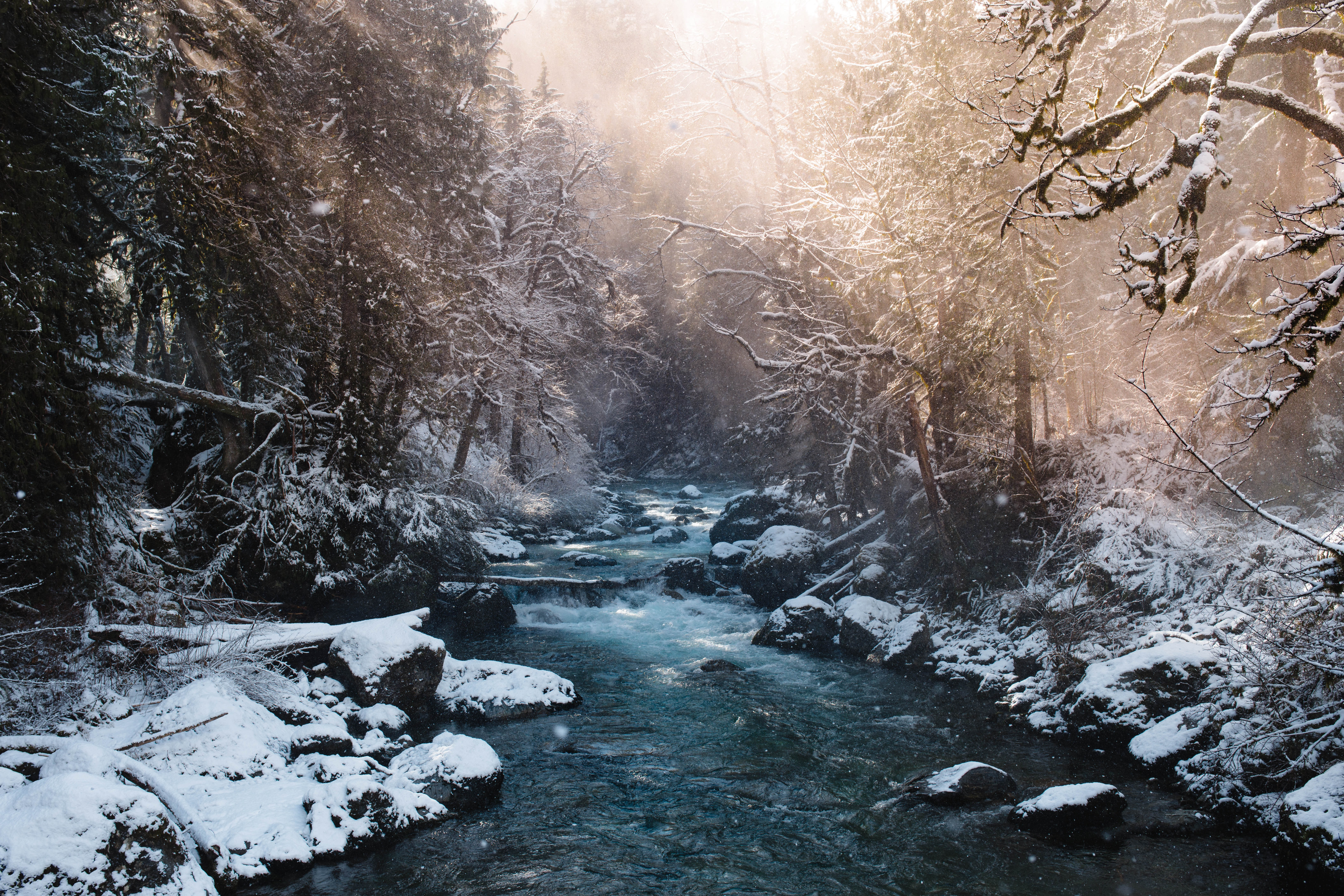 river between snow filled soil