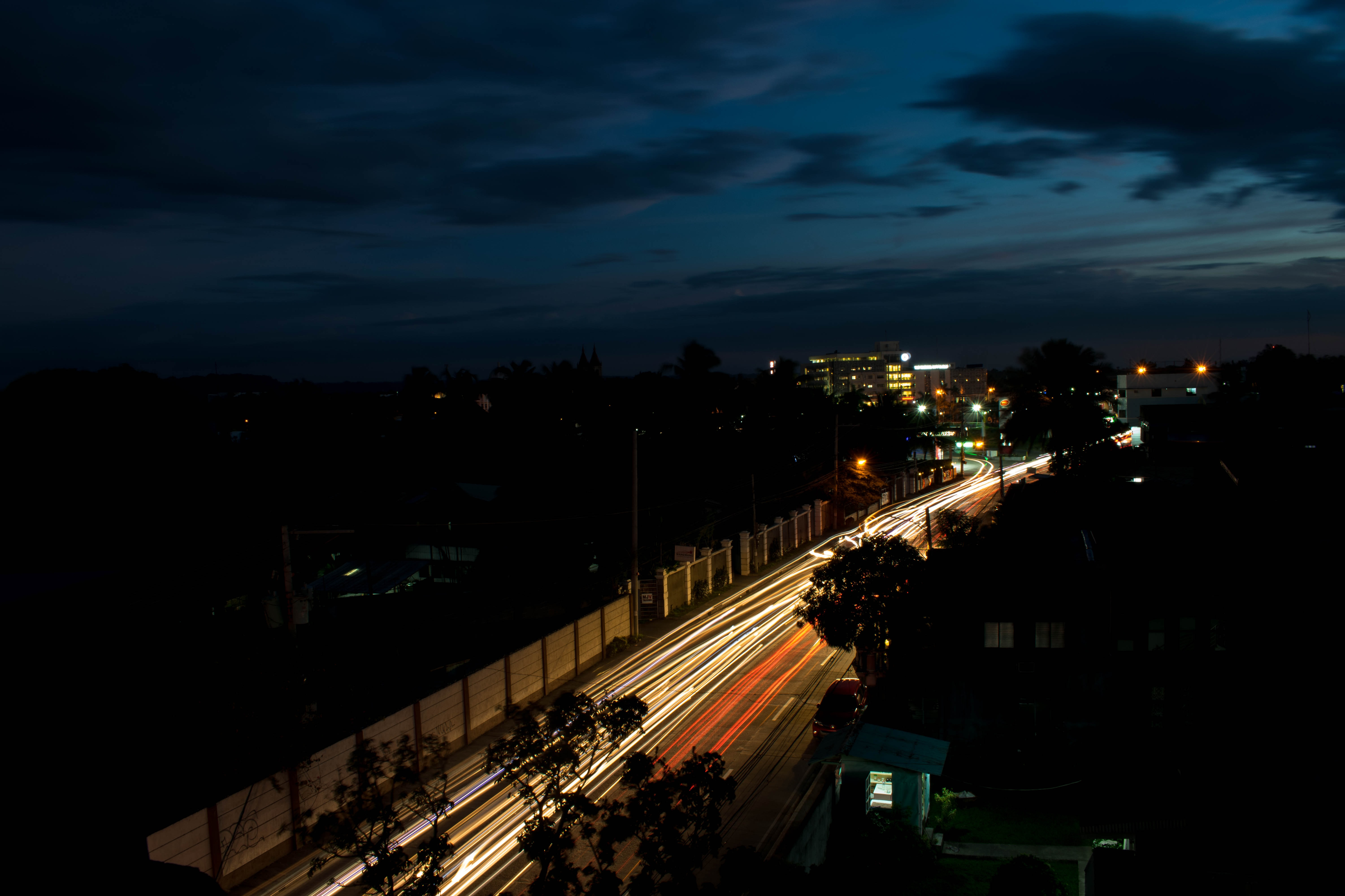 time lapse photography of cars on road at night