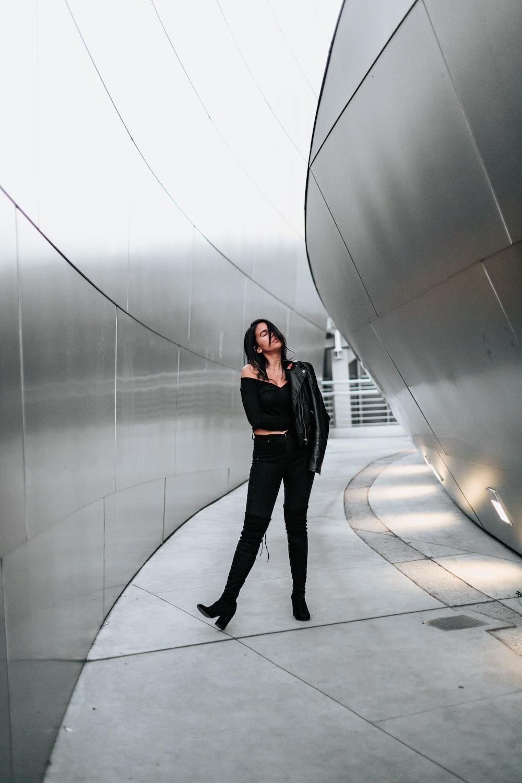 woman in black off-shoulder dress and black pants