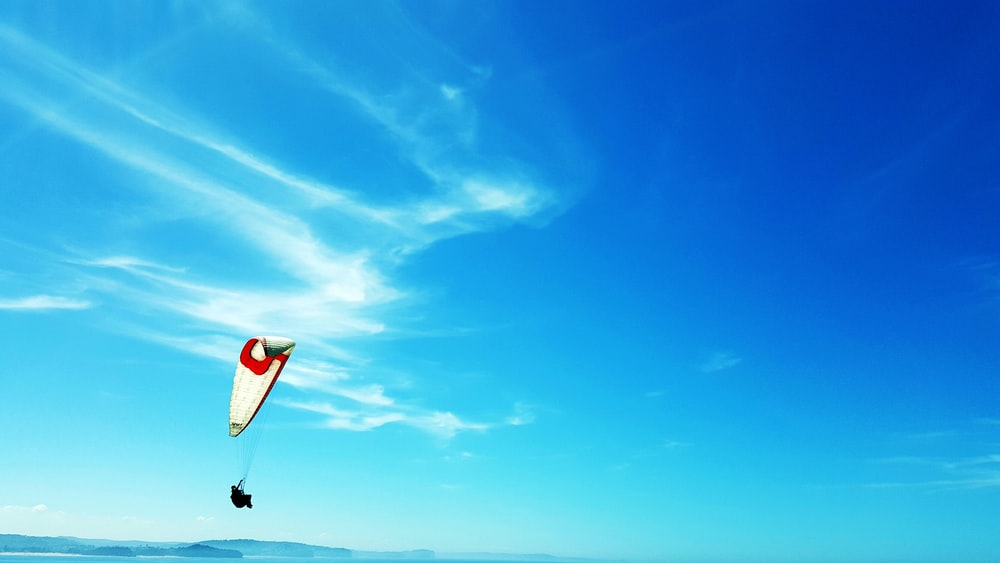 person paragliding during daytime