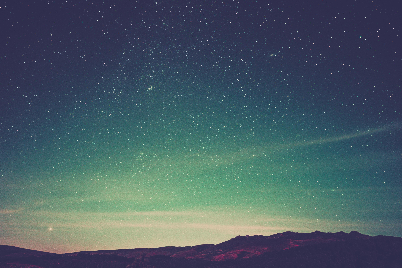 mountain under dark sky at night