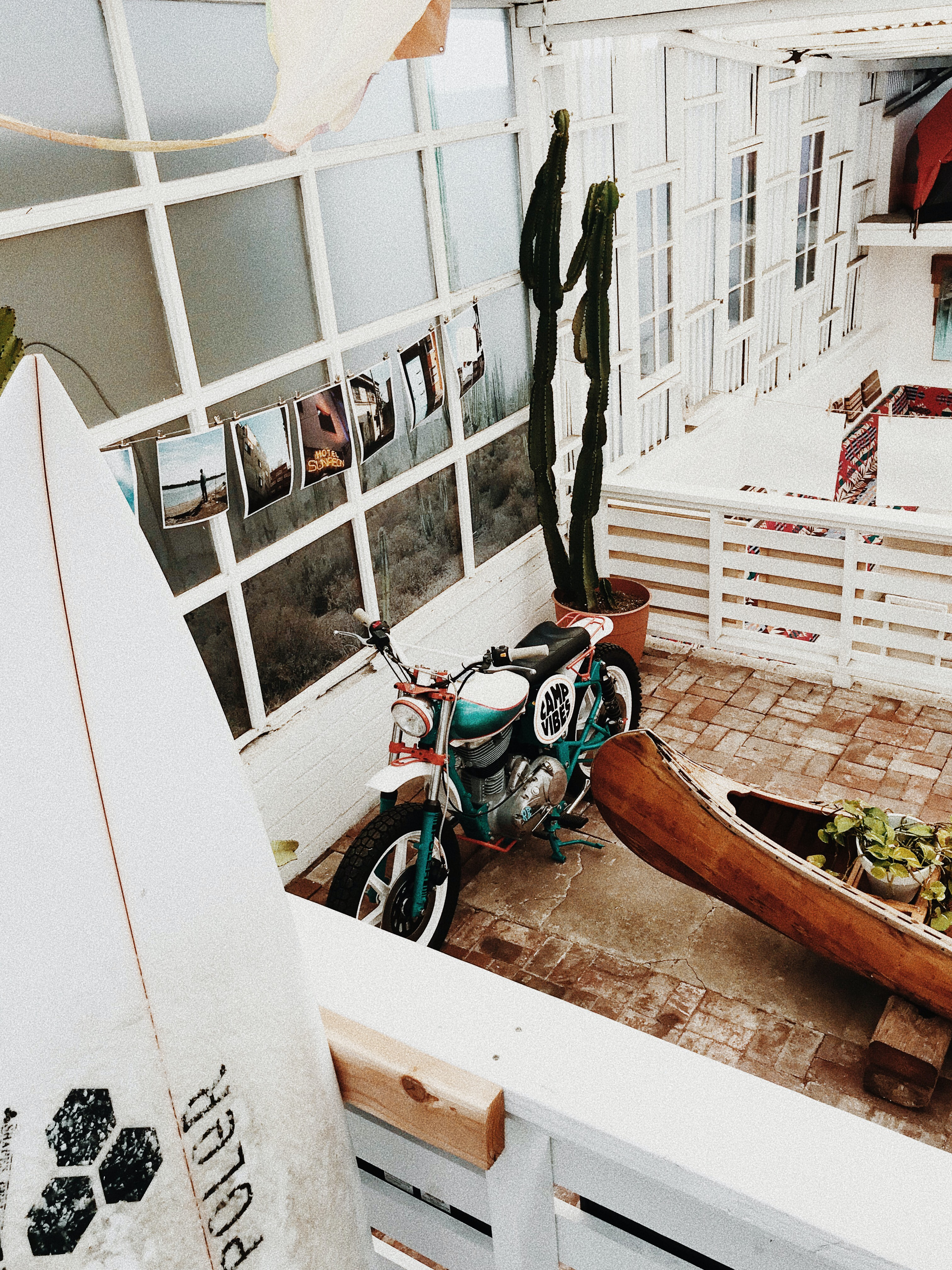 green motorcycle beside a brown wooden boat