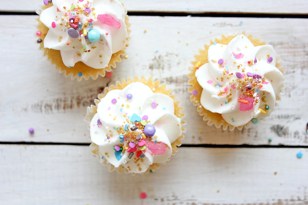 three cupcakes with toppings