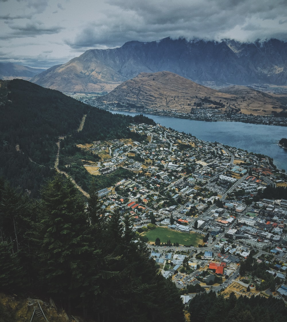 aerial view of cityscape near mountains