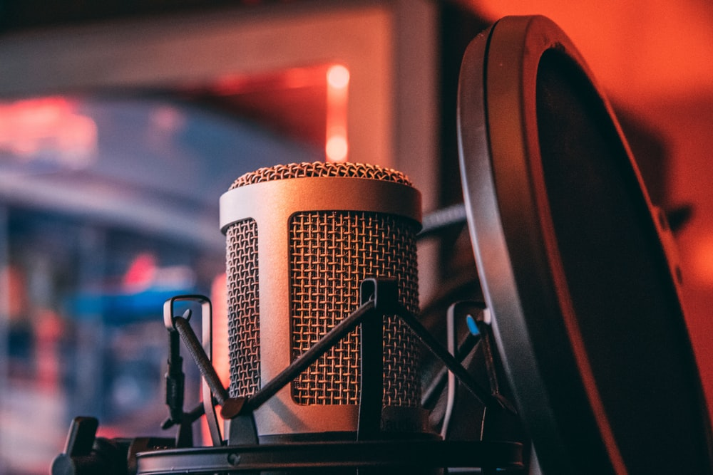 gray microphone beside of condenser