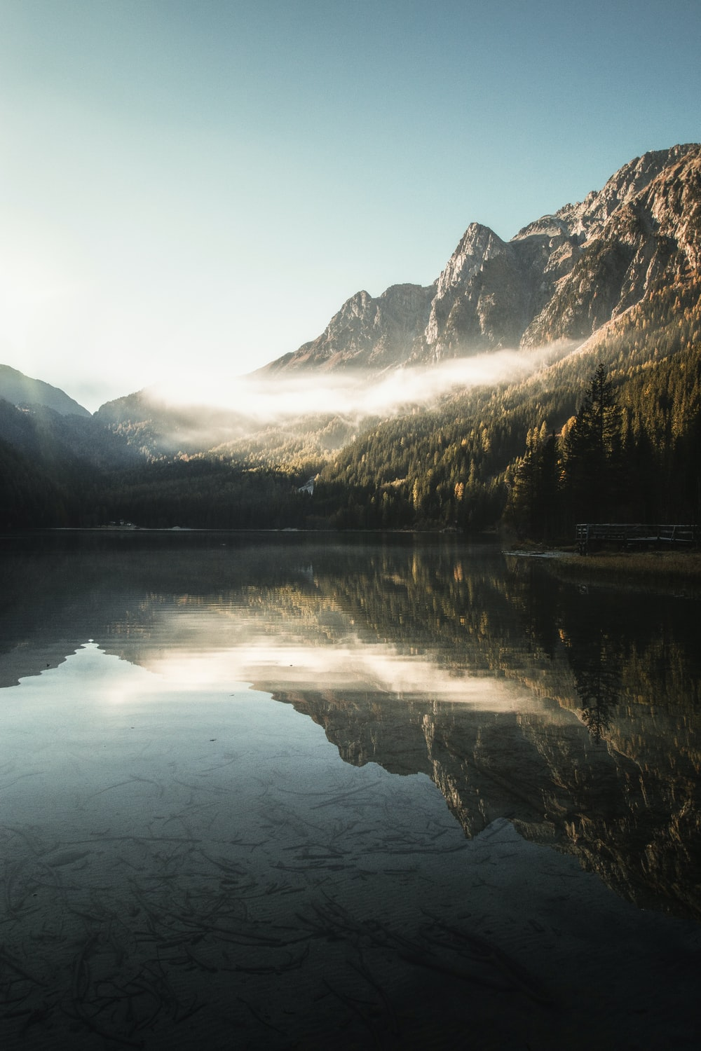 landscape photography of body of water against mountain