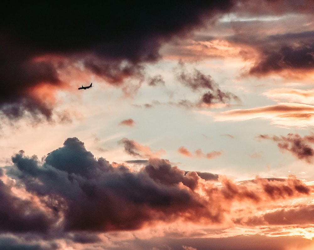 silhouette of airplane on sky