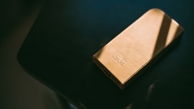 gold leather wallet on tabletop