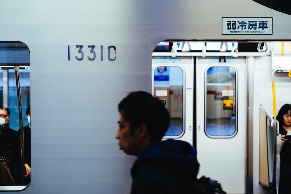 man walking beside train