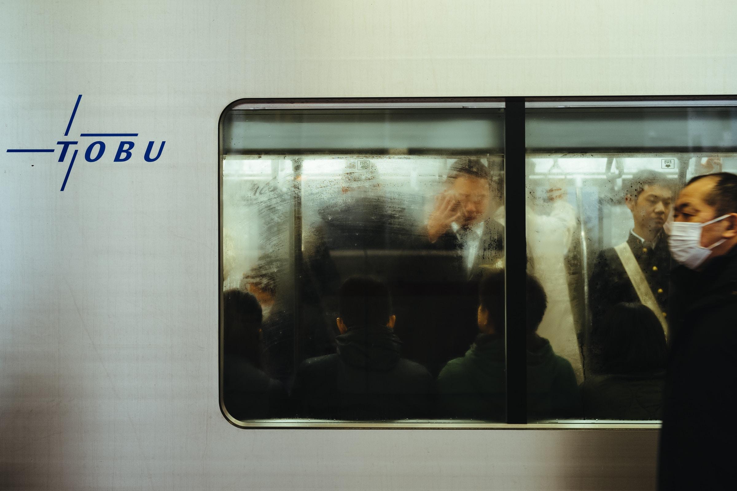 man beside gray train