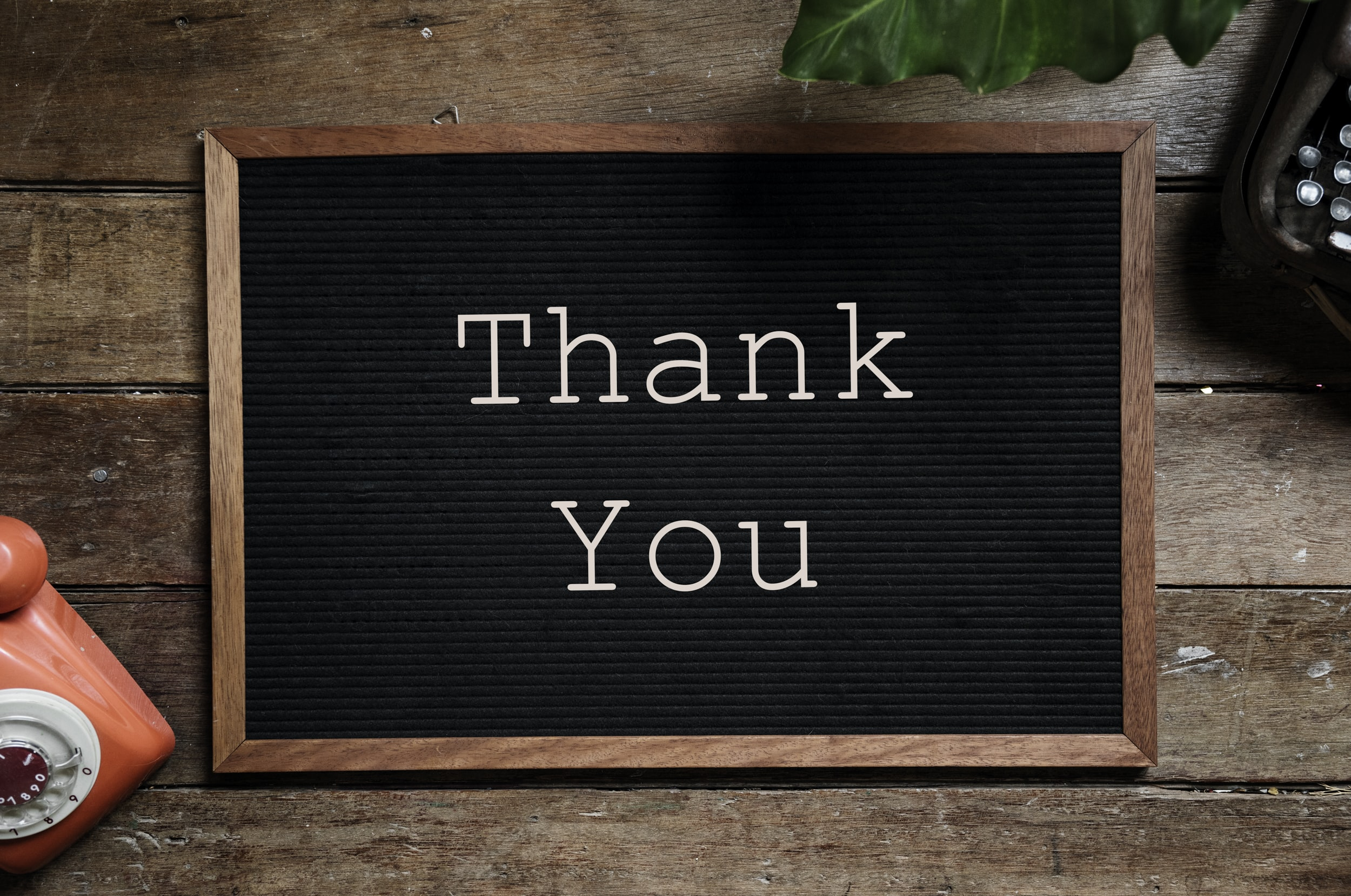 rectangular brown wooden framed chalkboard with thank you note