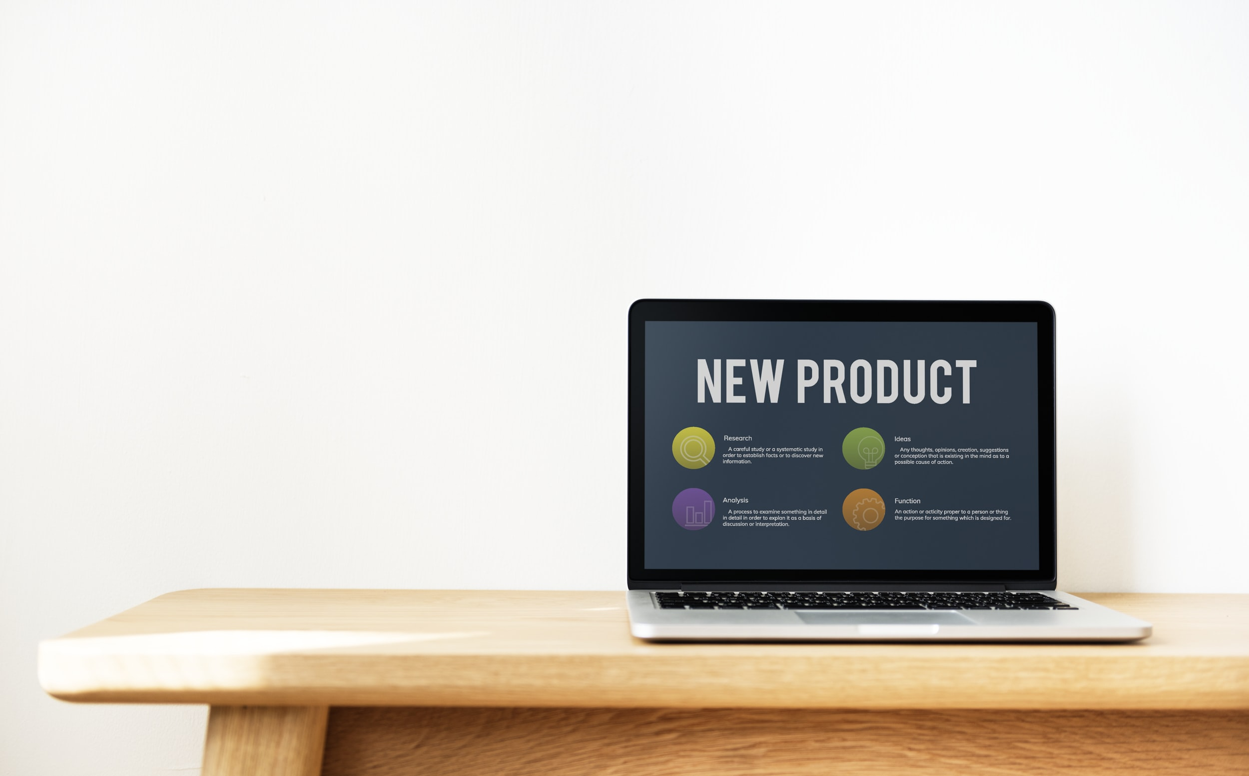MacBook Pro displaying New Product text
