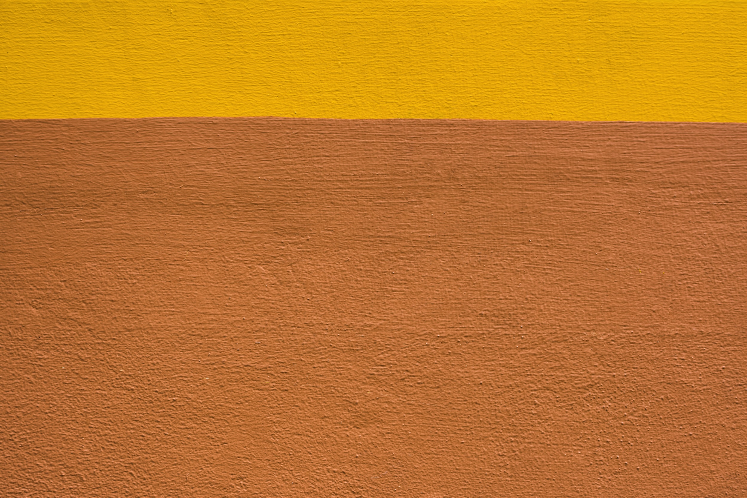 closeup of yellow and brown wall paint