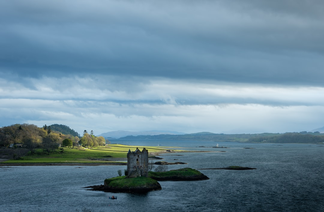 Over an hour waiting in the freezing wind all for a brief glimpse of light on the land that lasted a mere 5 seconds. That's what landscape photography is all about! Castle Stalker overlooking Loch Linnhe in the Scottish Highlands.