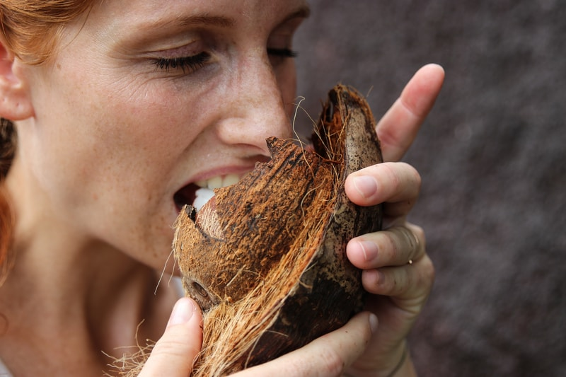 woman eating coconut meat