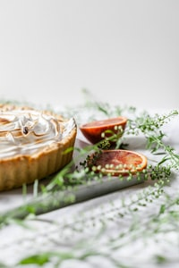 pie near sliced fruits