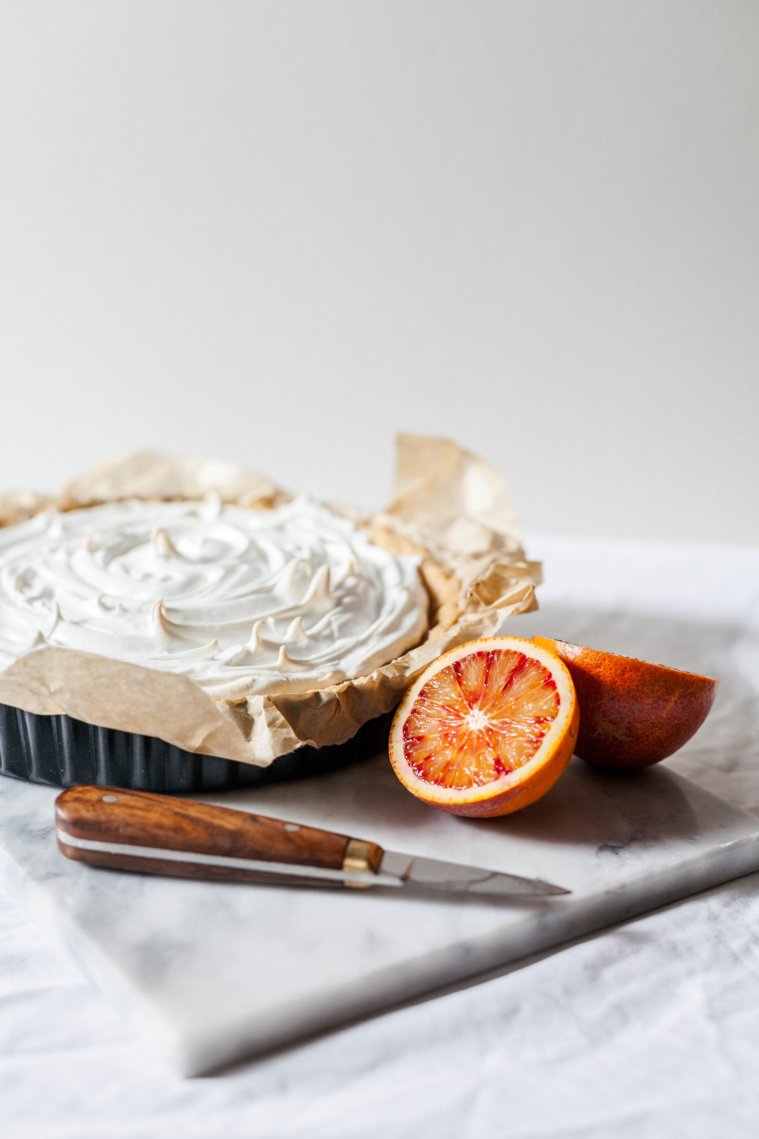 sliced orange fruits and white cupcake