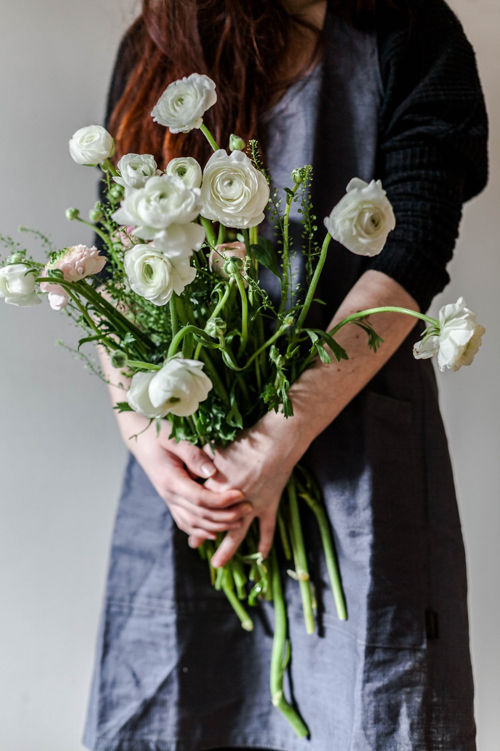 woman holding white roses