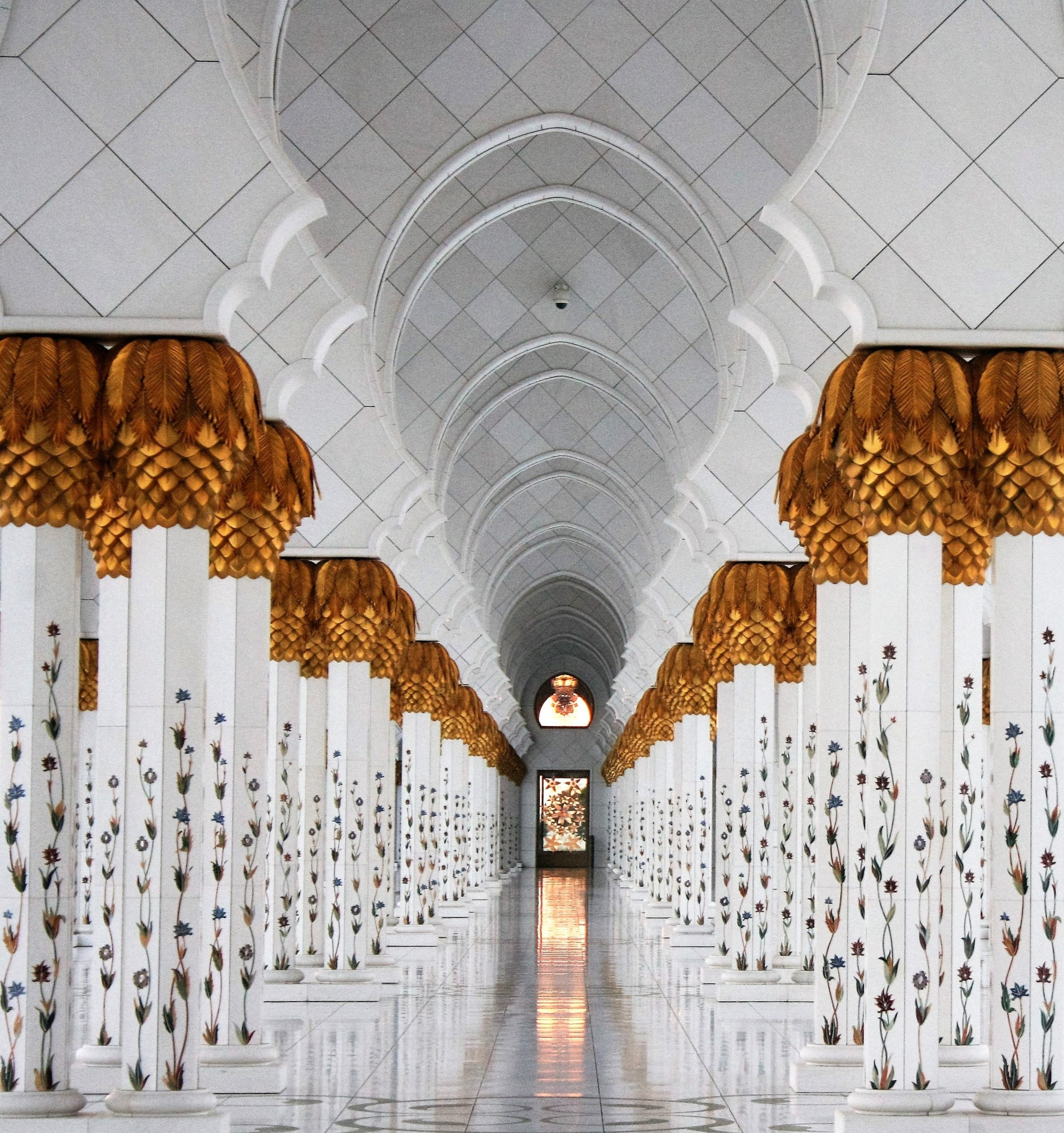 photo of white columns and marble tiles