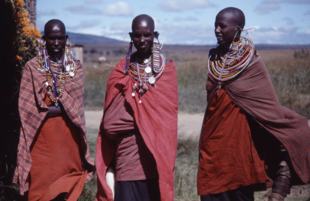 three women wearing capes outdoors