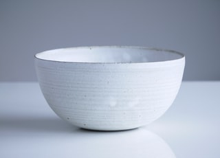 closeup photo of white bowl on white surface