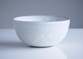 closeup photo of white bowl on white surface