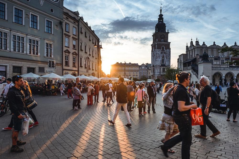 people walking on street near concrete buildings