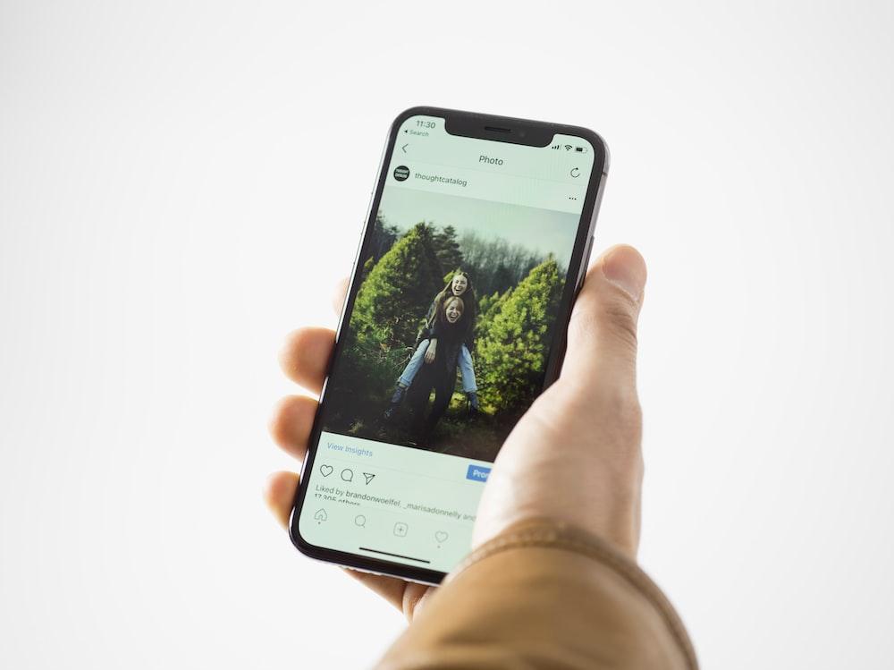 person using black smartphone