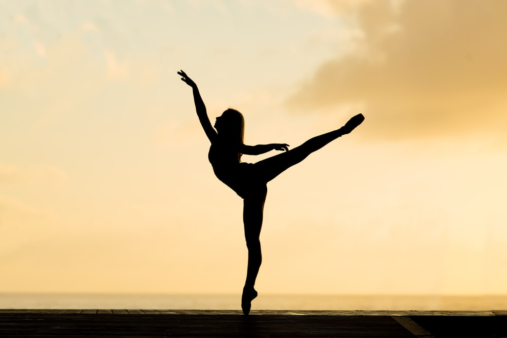 silhouette of woman dancing ballet