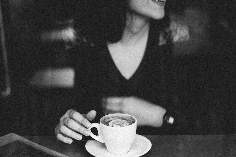 woman holding coffee mug