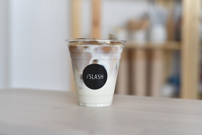 disposable cup filled with milk and ice united arab emirates zoom background