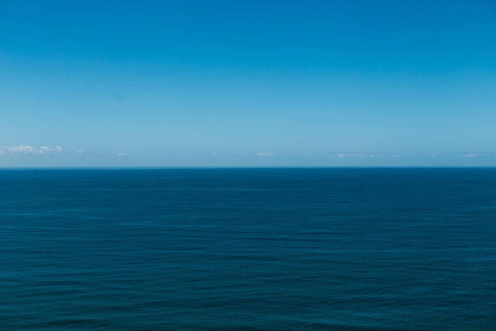 blue ocean under blue sky during daytime