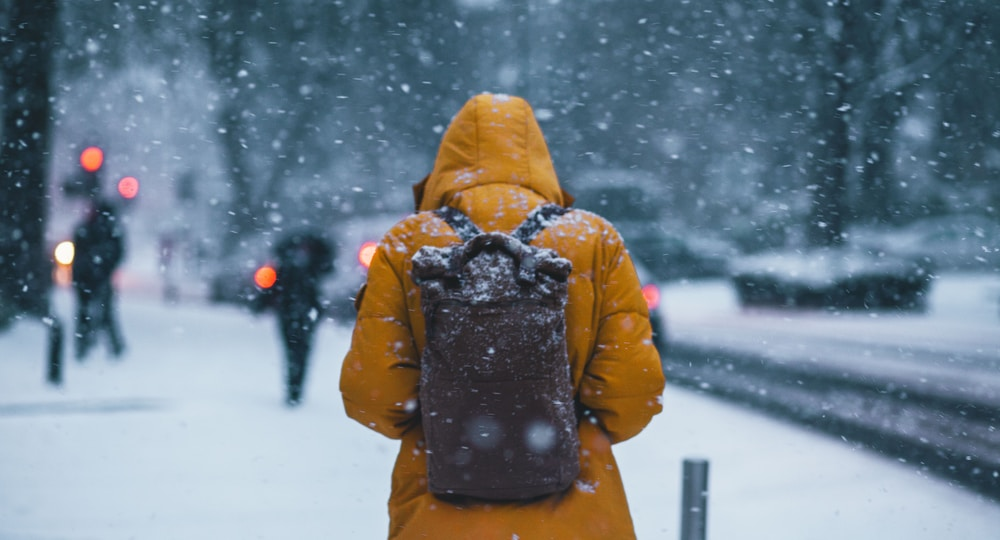 person wearing jacket and backpack
