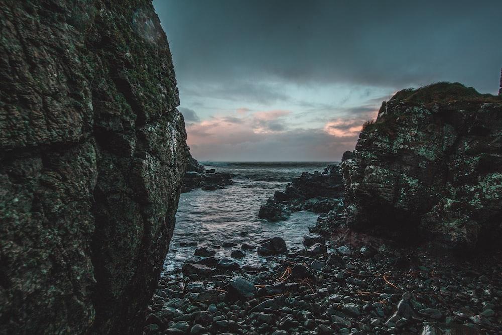 scenery of rock formation near body of water