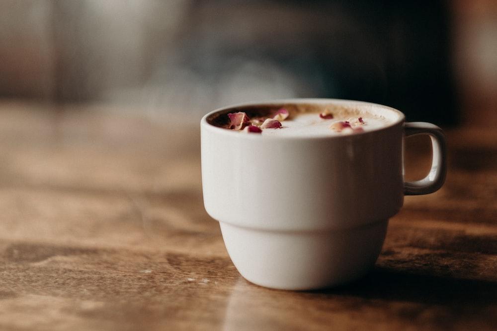 white ceramic mug filled with coffee at daytime