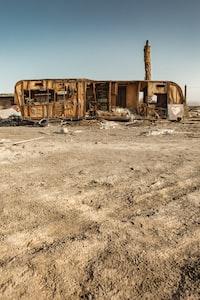 wrecked brown RV trailer
