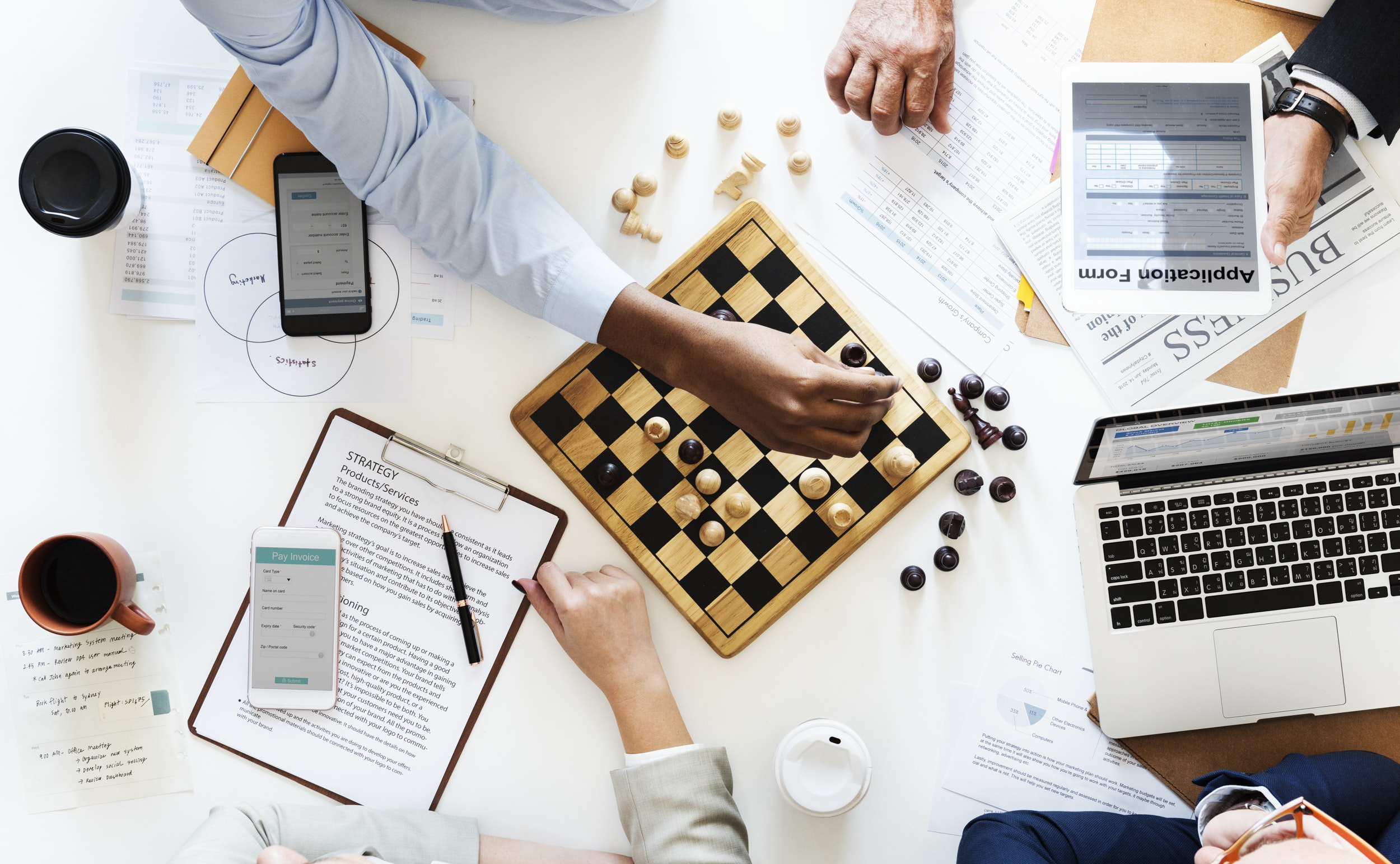 person playing chess board game