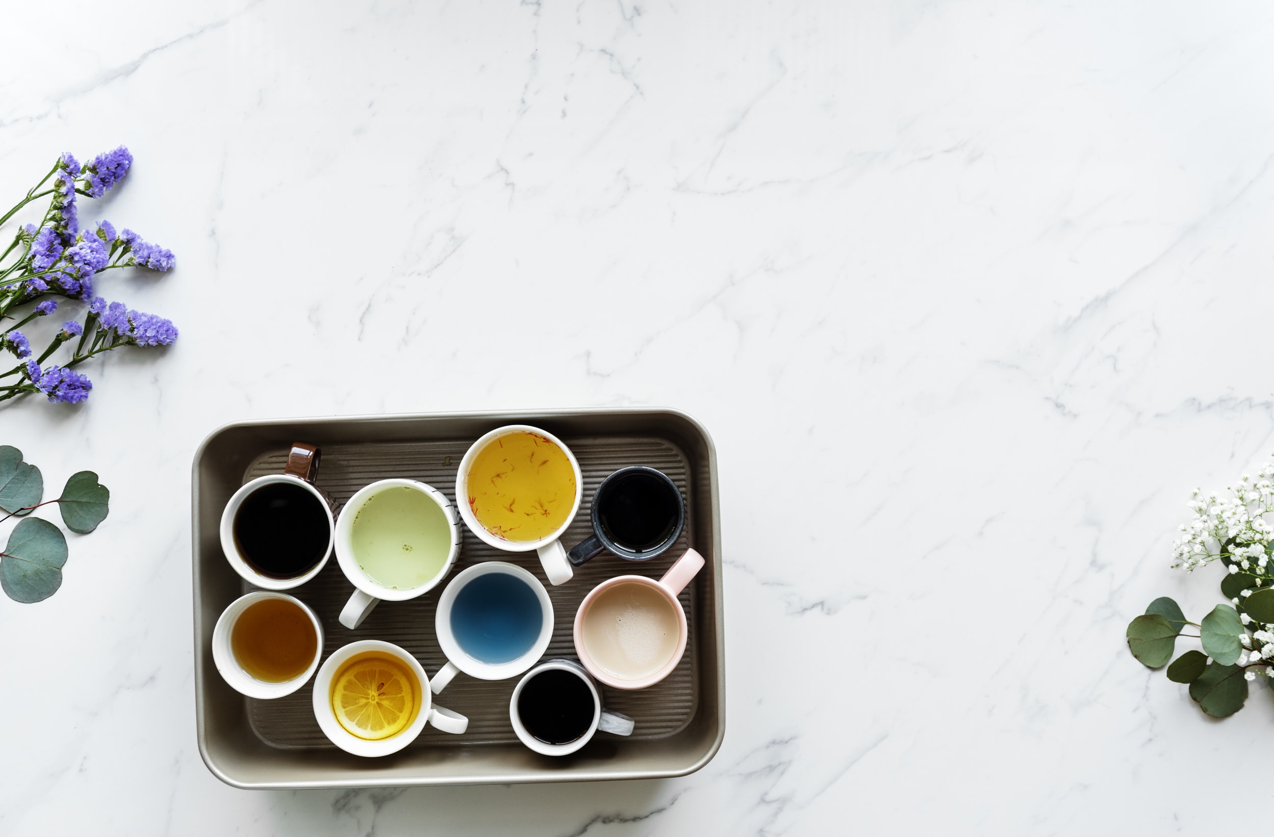 white ceramic cups on brown tray