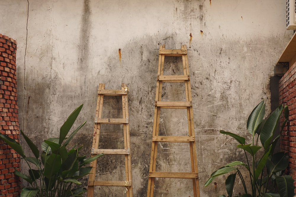 two brown wooden ladders