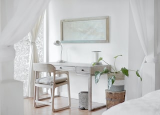 empty desk near curtain