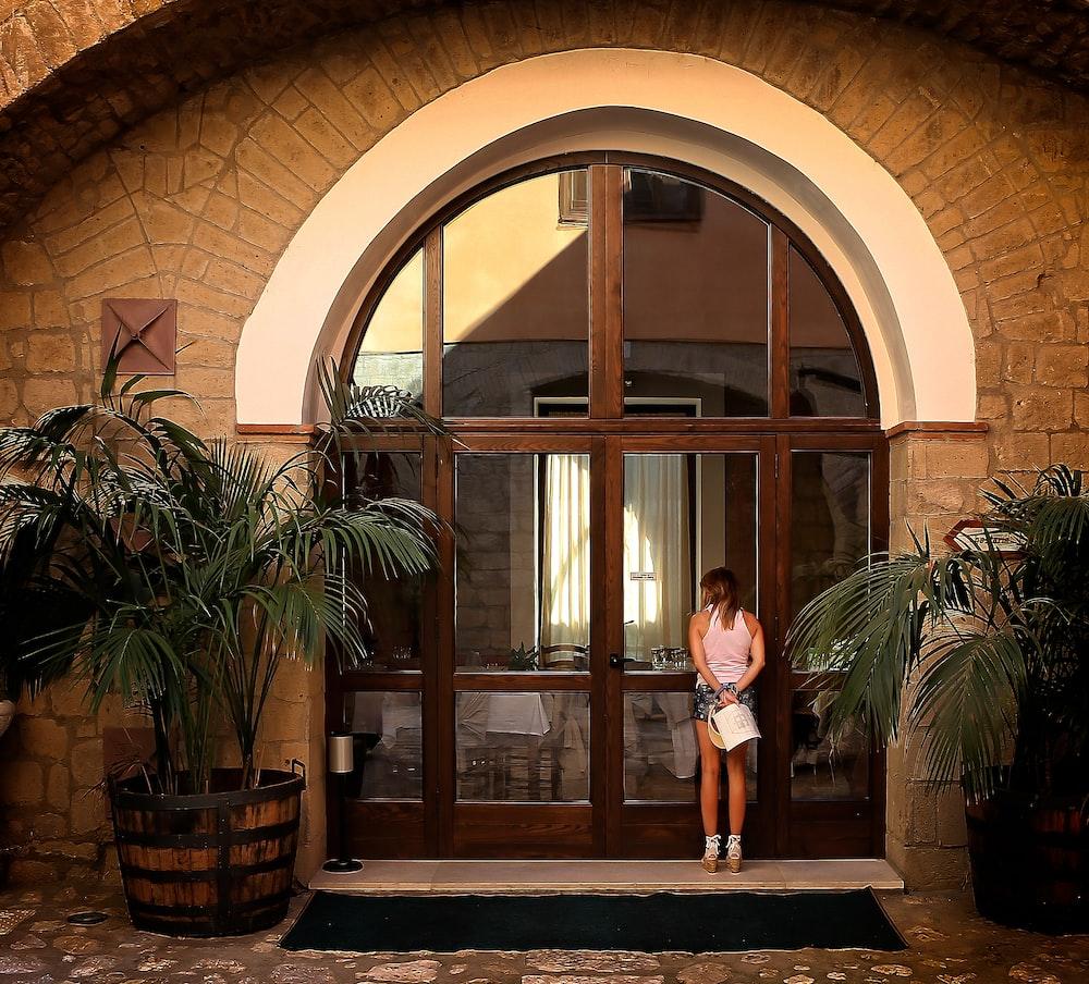 woman standing near the door