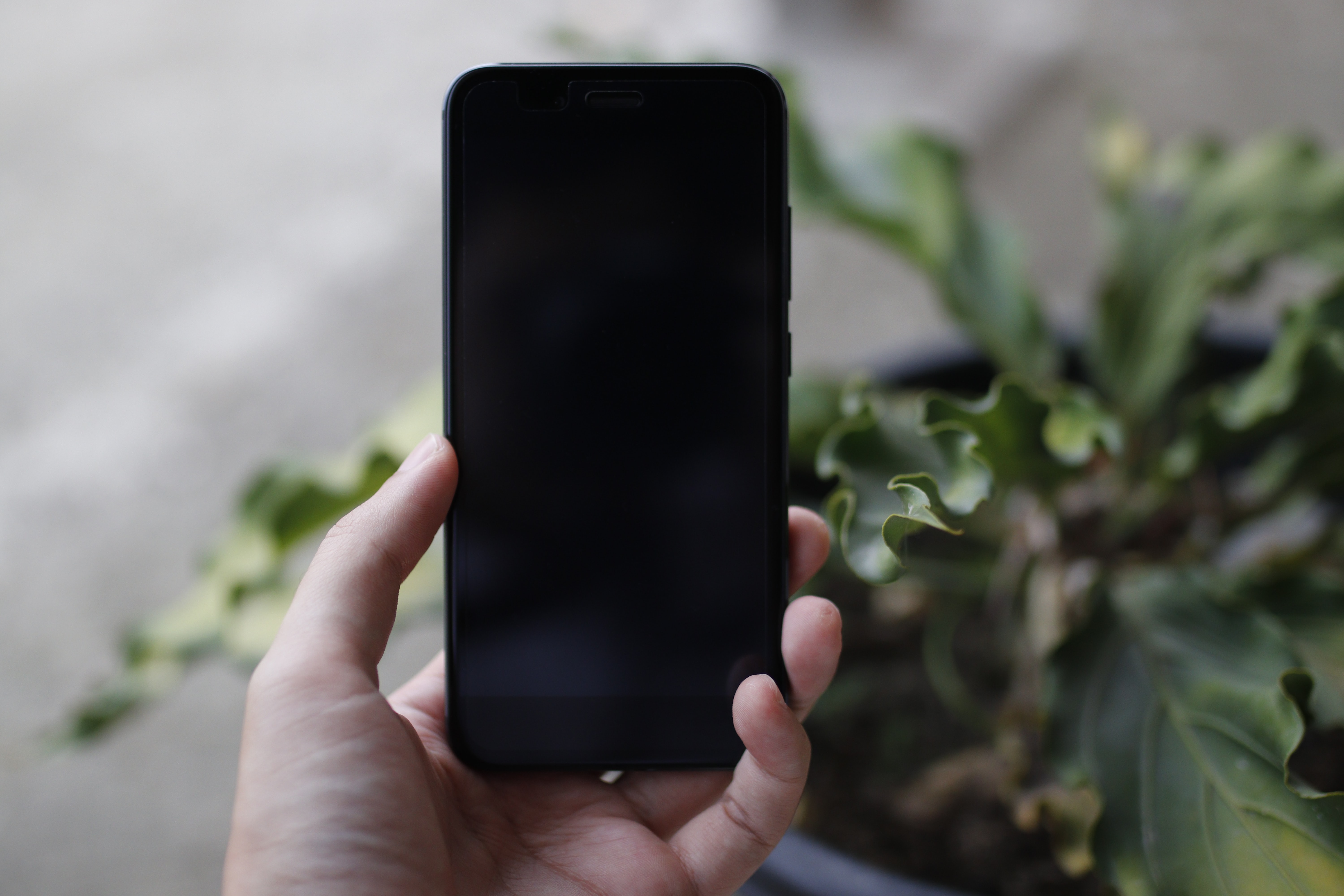 person holding turned off black smartphone