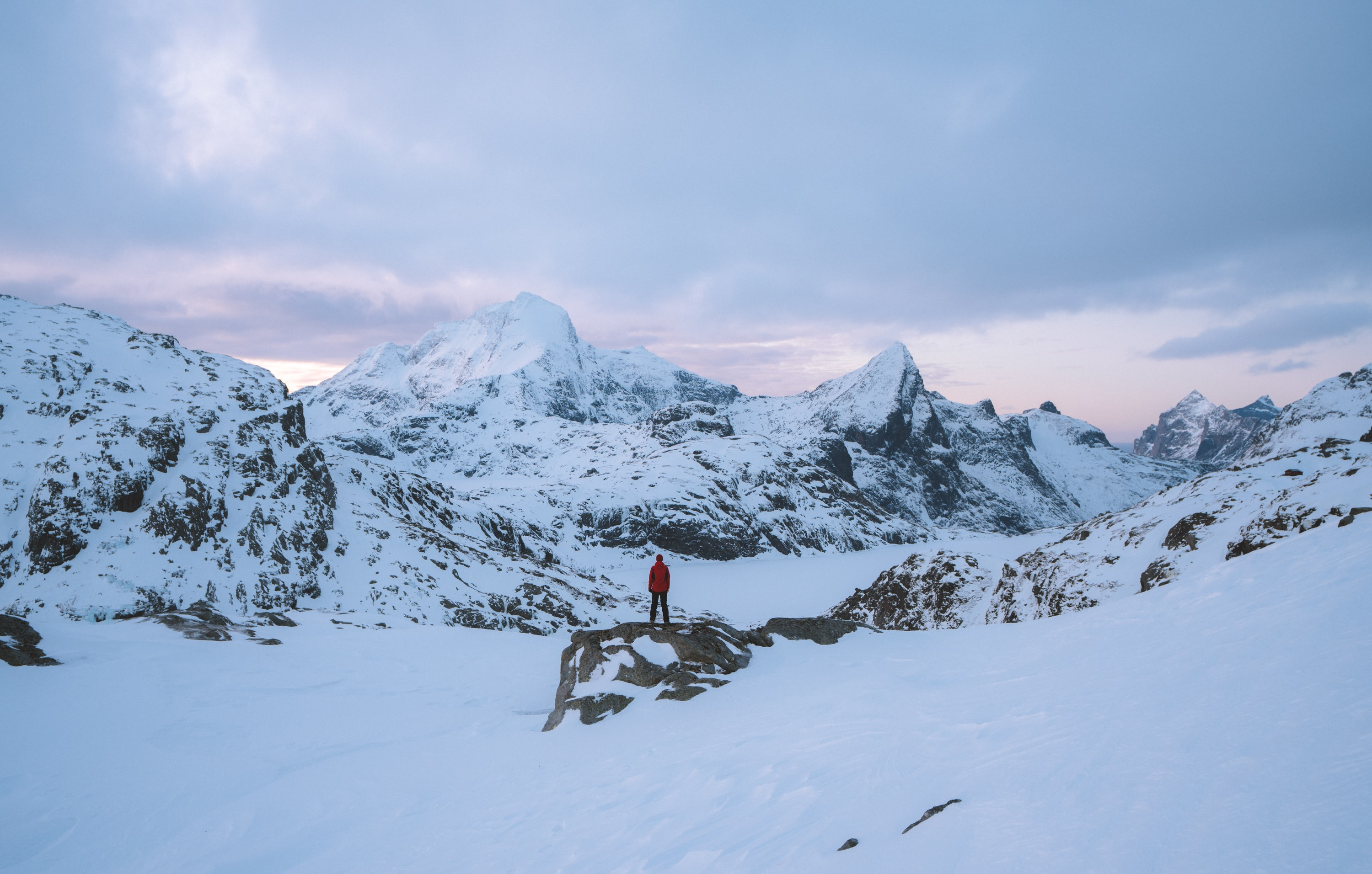 person standing in front of snow mountains