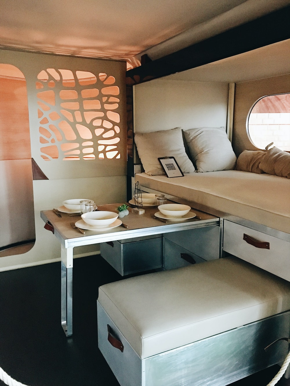 white wooden storage bed and table