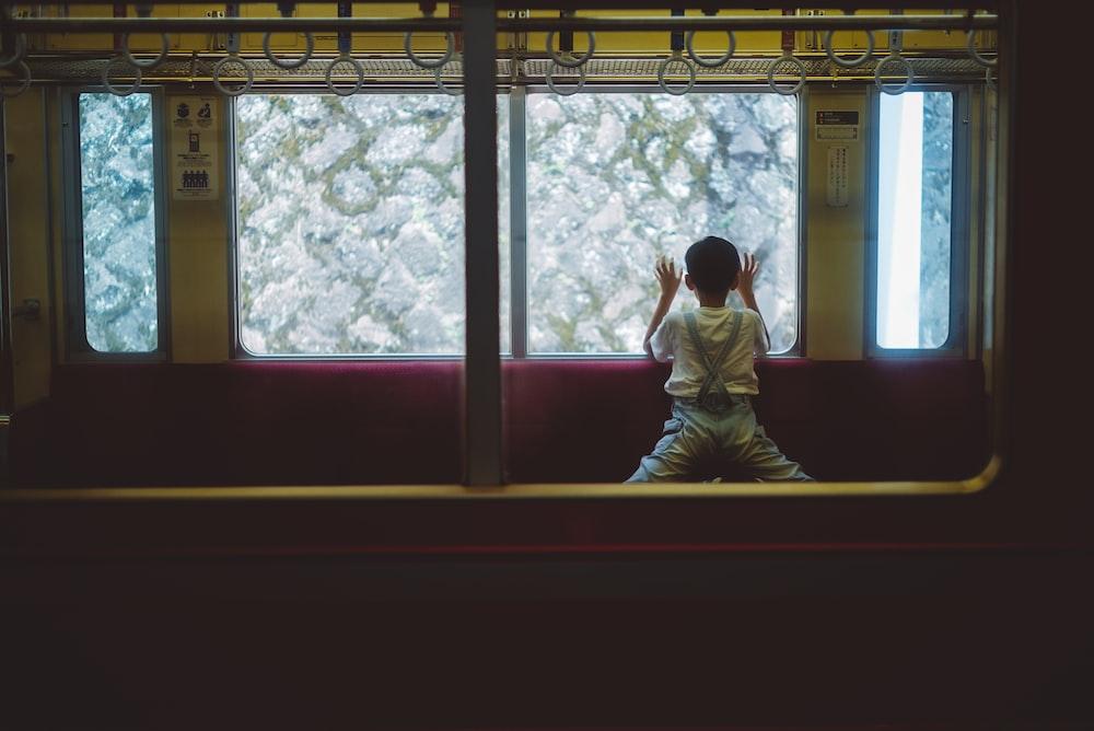 boy leaning on glass window