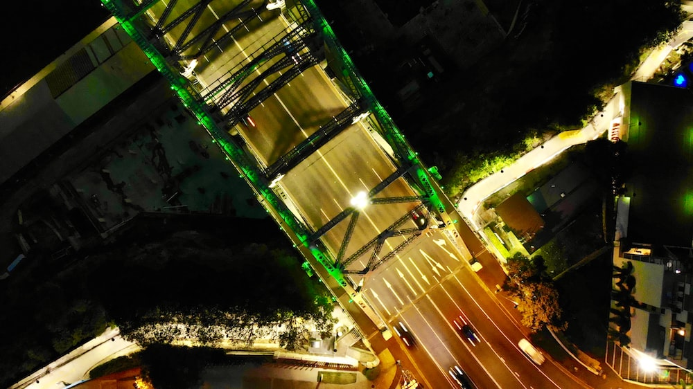 timelapse photography of cars on city road during night time
